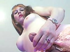 Cheeky shemale plays with her penis